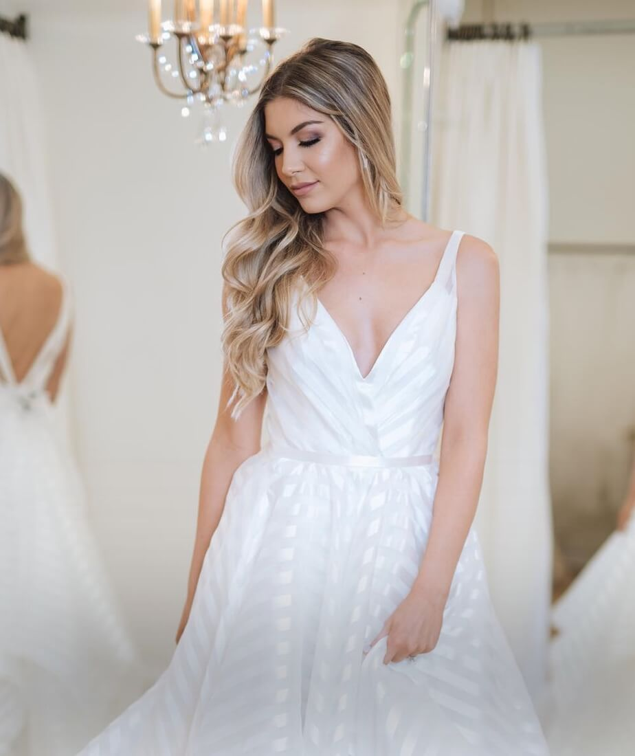 Blonde model in Hayley Paige gown